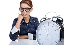 Woman at her desk at the end of the day Stock Photography