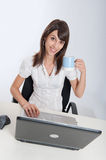 Woman at her desk with a mug Stock Photos