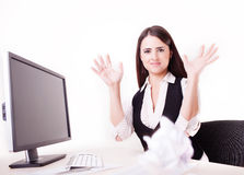Woman at her desk throwing a paper ball Stock Image