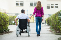 Woman With Her Disabled Husband royalty free stock photo