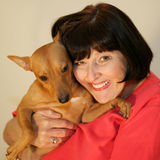 Woman and her dog. A smiling woman and her dog royalty free stock photos
