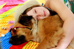 Woman with her dog. Young woman and dog on the beech Royalty Free Stock Image