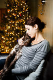 Woman and her dog. Young woman holding her dog at Christmas Royalty Free Stock Image