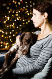 Woman and her dog. Young woman holding her dog at Christmas Stock Image