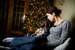 Woman and her dog. Young woman kissing her dog at Christmas Royalty Free Stock Image