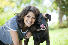 Woman with her dog. An early 40s woman with her hugging her black labrador retriever Stock Photography