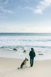 Woman with her dog at the beach Stock Photo