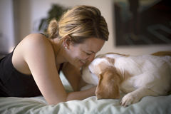 Woman with her dog in the bed at home. A woman with her dog in the bed at home Royalty Free Stock Photo