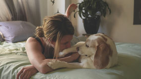 Woman with her dog in the bed at home. A woman with her dog in the bed at home Stock Photography