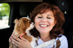 Woman with her dog in car Stock Photography