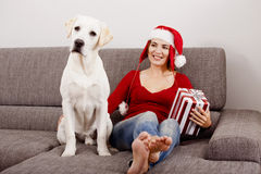 Woman with her dog on Christmas Day Royalty Free Stock Photography