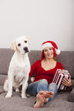 Woman with her dog on Christmas Day Stock Image