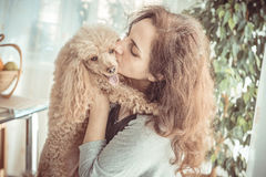 Woman with her dog at home. Young woman with her dog at home Stock Images