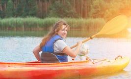 Woman and her dog on a kayak Stock Photos