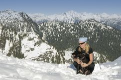 Woman with her dog in mountains Stock Photos