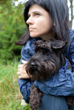 Woman with her dog in nature Royalty Free Stock Image