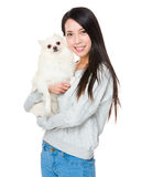 Woman with her dog. Over white background Stock Image