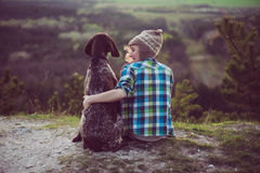 Woman and her dog posing outdoor. Stock Photos