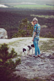 Woman and her dog posing outdoor. Royalty Free Stock Photography
