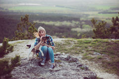 Woman and her dog posing outdoor. Royalty Free Stock Photos