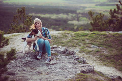 Woman and her dog posing outdoor. Royalty Free Stock Image