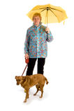 Woman with her dog in the rain Stock Photography