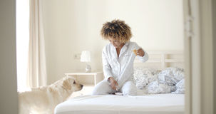 Woman And Her Dog Resting In Bed Royalty Free Stock Photos