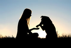 Woman and Her Dog Shaking Hands Silhouette Royalty Free Stock Photos
