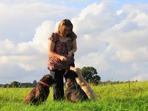 Woman and her dogs Stock Photos