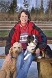 Woman and her Dogs - Focus on Woman's face royalty free stock photos