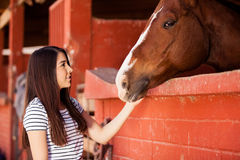 Woman during her equine therapy Royalty Free Stock Images