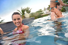 Woman with her family enjoying swimming pool Royalty Free Stock Images