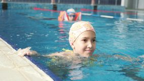 A woman and her family are swimming in the pool. stock footage