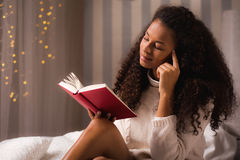 Woman with her favorite book Royalty Free Stock Photography