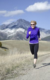 Woman in her fifties running in Montana Royalty Free Stock Images