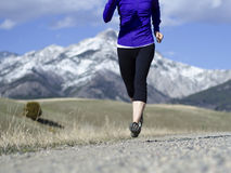 Woman in her fifties running in Montana Royalty Free Stock Image