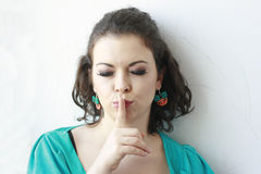 Woman with her finger on her lips Royalty Free Stock Image