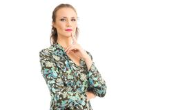 Woman with her finger resting on the tip of her chin. She is blo Royalty Free Stock Photography