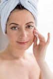 Woman in her forties removing make up Royalty Free Stock Images