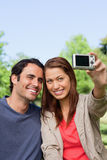 Woman and her friend looking towards her camera for a picture of Stock Photo
