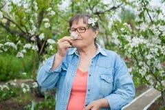 Woman  in her garden Stock Photos