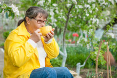 Woman in her garden Stock Images