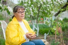 Woman in her garden Stock Image
