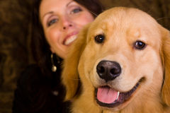 Woman with her golden retriever Stock Photo