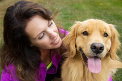 A woman and her golden retriever Royalty Free Stock Image