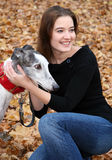 Woman with her greyhound stock images