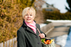 Woman with her groceries Stock Photo