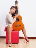 Woman with her guitar royalty free stock photo