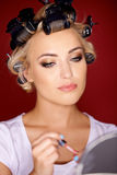 Woman with her hair in curlers Royalty Free Stock Image