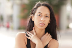 Woman with her hands around her neck Stock Photography